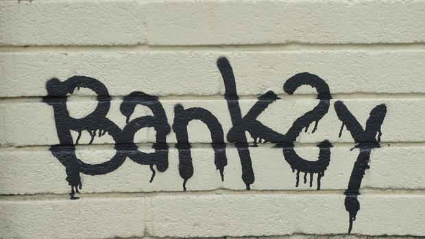 A Banksy signature on a mural (PA)