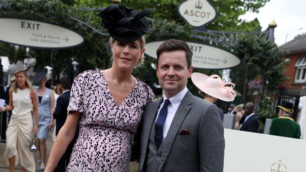 Declan Donnelly and Ali Astall pose for photographers on day two of Royal Ascot at Ascot Racecourse.