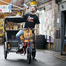 Comedian Joel Dommett sets off from the Pleasance Grand, Edinburgh, on a rickshaw to visit 100 shows at the Edinburgh Fringe Festival (Jane Barlow/PA)