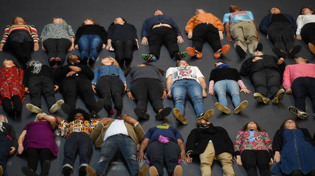 Guests lie on Tania Bruguera's Hyundai Commission, a heat-sensitive floor (Kirsty O'Connor/PA)