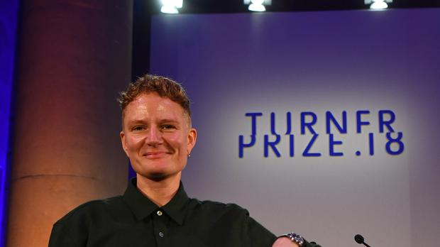 2018 Turner Prize winner Charlotte Prodger accepts the award during a ceremony at Tate Britain in London. (Victoria Jones/PA)