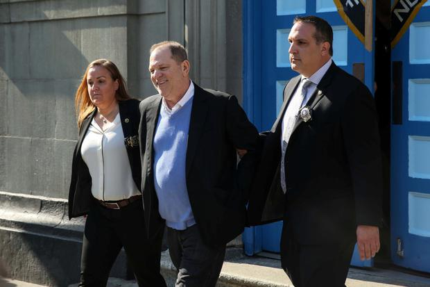Disgraced film producer Harvey Weinstein is led from court