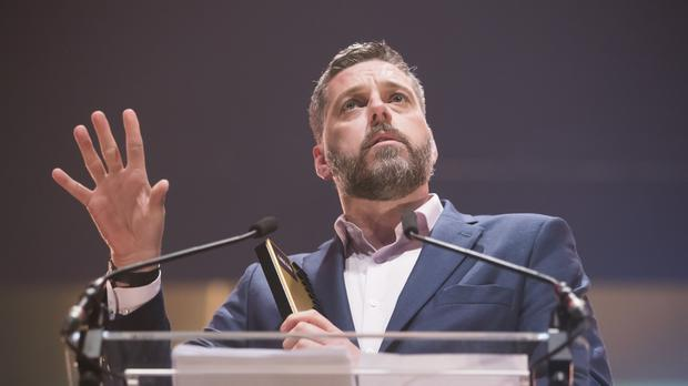 Radio host Iain Lee kept a suicidal caller on the line until an ambulance arrived (Danny Lawson/PA)