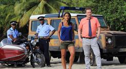 Ardal O'Hanlon with co-star Josephine Jobert in the BBC's 'Death In Paradise' - which draws an average weekly audience of nine million viewers