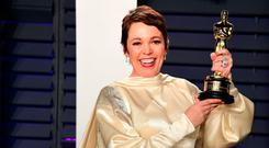 Olivia Colman holds aloft her Best Actress Oscar for The Favourite. Photo: PA