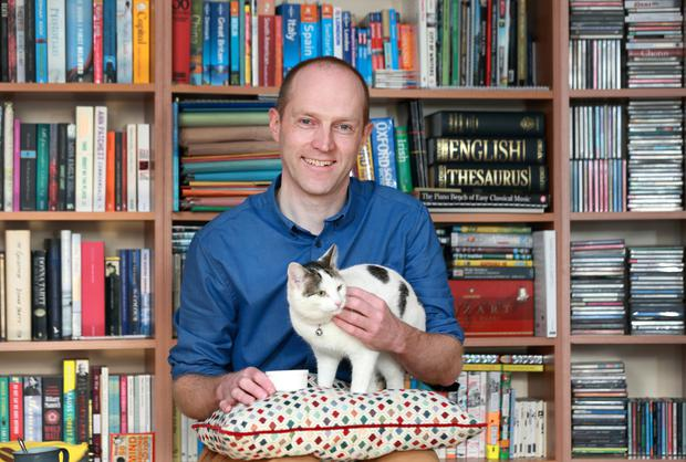 Prof Brendan Kelly with Trixie at his home in Dublin. Photo: Frank McGrath