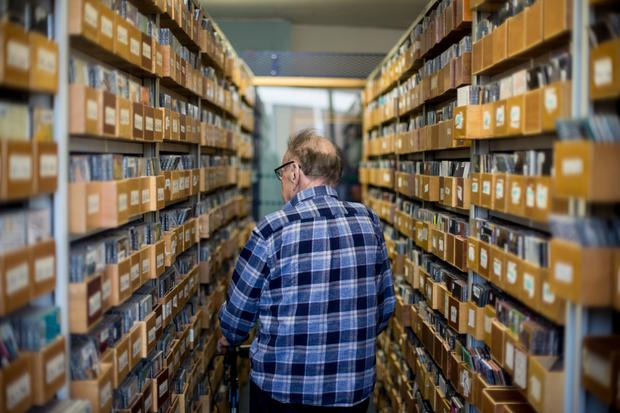 Larry Gogan browses the 2fm music archives. Photo: Mark Condren