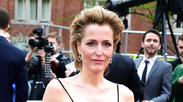 Gillian Anderson on the red carpet (Ian West/PA)