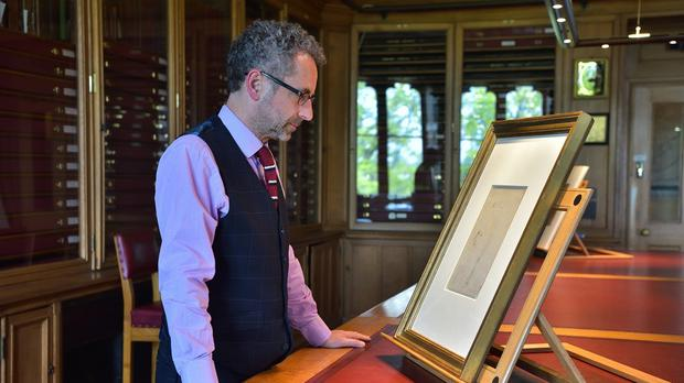 Martin Clayton, of the Royal Collection Trust, studies what he says is a sketch of Leonardo da Vinci (Royal Collection Trust/ Her Majesty Queen Elizabeth II 2019/PA)