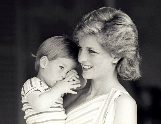Mammy's little prince: Harry with his adoring mother Princess Diana in 1988