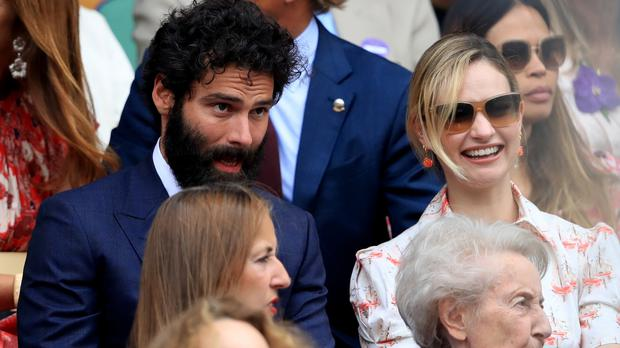 Aidan Turner and Lily James in the crowd (Adam Davy/PA)