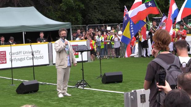 Actor Michael Sheen delivers the opening address at the 2019 Homeless World Cup in Cardiff, Wales (PA)
