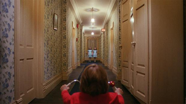 Danny encounters the twin girls at the end of a corridor in the Overlook Hotel