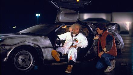 Christopher Lloyd (Dr Emmett Brown) and Michael J. Fox (Marty McFly) with a DeLorean car in the 1985 film Back to the Future