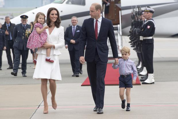 The Duke and Duchess of Cambridge and Prince George and Princess Charlotte in Warsaw in 2017 (Arthur Edwards/The Sun/PA)