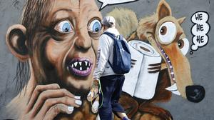 """Sketchy behaviour: A mural in Berlin featuring Gollum and Scrat with a message reading """"my precious"""""""