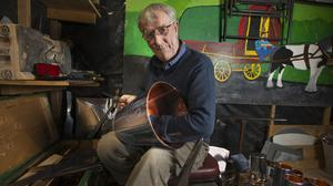 Tinsmith Tom McDonnell works on a copper bucket in his shed in Finglas. Picture by Tony Gavin