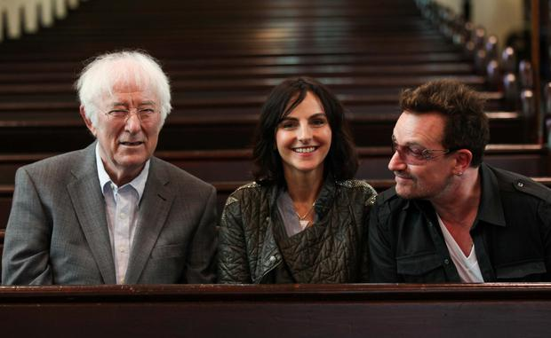 Memories: Festival director Sian Smyth, centre, talks books with Bono, right, and the late Seamus Heaney at the Dalkey Book Festival in 2012. Photo: Conor McCabe. For more information visit www.dalkeybookfestival.org