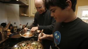 Michael Pollan and his son Isaac make lunch. Picture by Liz Hafalia