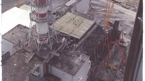 Tomb: Construction work to seal off Chernobyl in the aftermath of the 1986 tragedy. Photo: Igor Kostin/Sygma