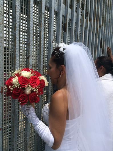 Through the barricades: a deported Mexican woman talks to her mum on the US side of the border on her wedding day