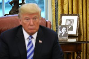 Family values: Donald Trump in front of photographs of his mother Mary and father Fred in the Oval Office