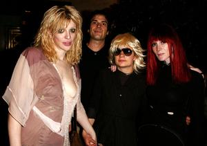 Courtney Love, Geoffrey Knoop, JT LeRoy (Savannah Knoop) and Speedie (Laura Albert) at an after-party during New York Fashion Week 2003.  Photo: Matthew Peyton/Getty