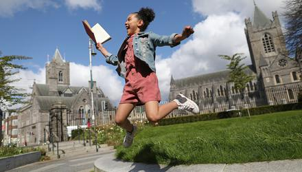 What a twist: Alisha Katongole (8) at the Peace Garden in Dublin, to mark this year's International Literature Festival Dublin. Photo: Julien Behal
