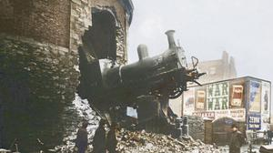 TRAIN CRASH 1900, Hatch Street, Dublin Harcourt Street Station opened in 1859 and served as the terminus of the line from Dublin to Bray. It closed in 1958, but the station is perhaps best remembered for the crash in 1900 that saw a cattle train from Enniscorthy crash through the end wall, leaving the engine suspended over Hatch Street. Luckily nobody was killed, though the driver, William Hyland, had to have his right arm amputated. The engine had to be lowered down onto existing tram tracks, moved to Harcourt Road and then, on a temporary track, back to the station. In this image, we can see ads for Bovril, Pickapack Cigarettes, Manders Pale Ale, Quaker Oats, Zebra Grate Polish and TH White's Wafer Oats. Photographer: Unknown, Source: Dublin City Library and Archive