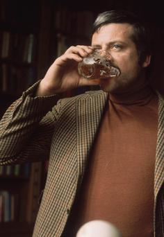 Like clockwork: Oliver Reed enjoys another drink at his huge ex-monastery home in Broome Hall in Surrey, England, in 1973
