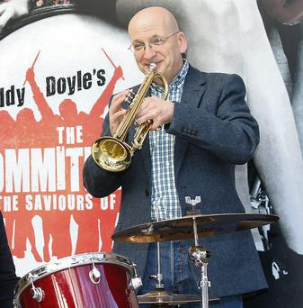 Roddy Doyle playing the trumpet at the launch of his play 'The Commitments'