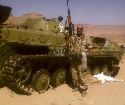 Battle zone: Housam 'Sam' Najjair, in Libya after he joined the rebel forces fighting against the Gadaffi regime.