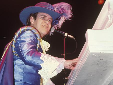 Flamboyant: Elton John underwent a dramatic transformation from his previous incarnation as Reg Dwight the office boy in Tin Pan Alley.