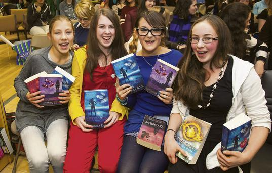 Miriam Sarzynska, left, Chloe Duggan, Inez Szulc and Grainne Duggan, right, fans of the 'Divergent' series at a signing in Eason, Dublin.