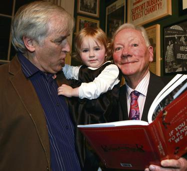Gay Byrne with author Myles Dungan and his daughter Gwyneth at the launch