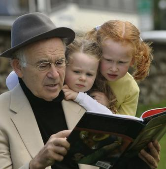 Once upon a time... Storyteller Batt Burns reads to his granddaughters Aisling and Laoise. Dominick Walsh
