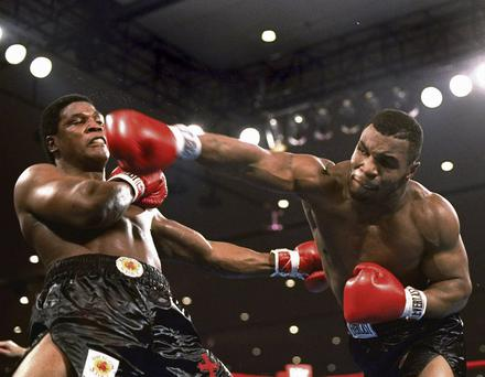 Champion: Mike Tyson delivers a powerful blow to Trevor Berbick in the second round of their fight in Las Vegas in 1986. Photo: AP