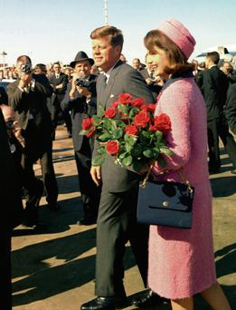 One day in Dallas: Jackie arriving at Love Field in that pink suit with JFK on November 22, 1963.