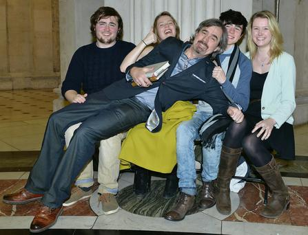 Author Sebastian Barry relaxes with his children, (left to right) Merlin, Coral, Tobias and Hannah, during the launch of Sebastian's book 'The Temporary Gentleman at the Rotunda in Dublin City Hall. Photo: Barbara Lindberg