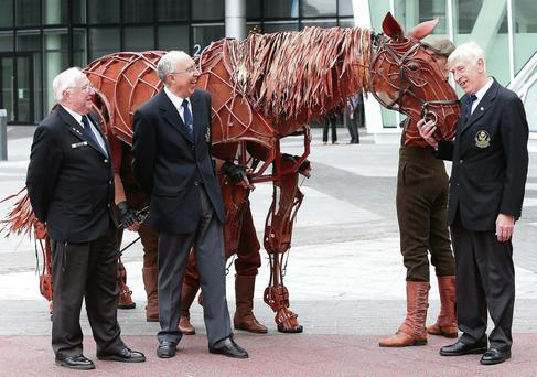 Veterans Tony Roe, Gerry McCann and Noel Murphy meet 'Joey' the War Horse at the Bord Gais Energy Theatre. Photo: Damien Eagers