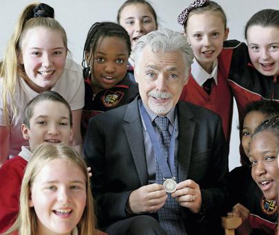 Students from Rutland National School, Dublin, with author Eoin Colfer, who has been announced as the new Laureate na nOg. Photo: Maxwells