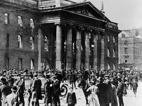 Bloody history: Onlookers mill around Dublin's GPO after the 1916 Rising