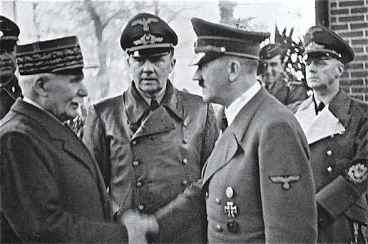Warm welcome: Philippe Pétain, president of French Vichy regime during World War II, greets the German Führer Adolf Hitler