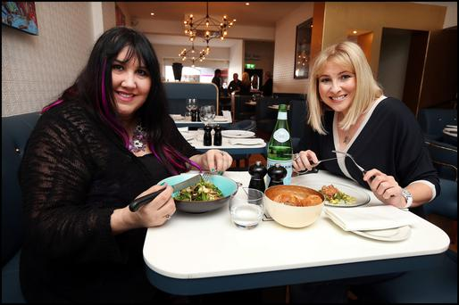 New venue: Andrea Smyth and Anna McPartlin enjoy lunch at Nick Munier's restaurant, Avenue. Photo: Steve Humphries