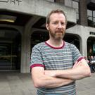 Boom and bust: Paul Murray outside the old Anglo Irish building on St Stephen's Green, Dublin. Photo: Arthur Carron