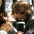 Carrie Fisher and Harrison Ford lock lips in 'Star Wars'. Fisher told Ford about the book in advance and he was also sent a pre-publication draft
