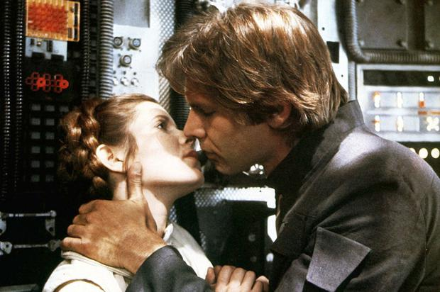 Carrie Fisher and Harrison Ford lock lips in The Empire Strikes Back