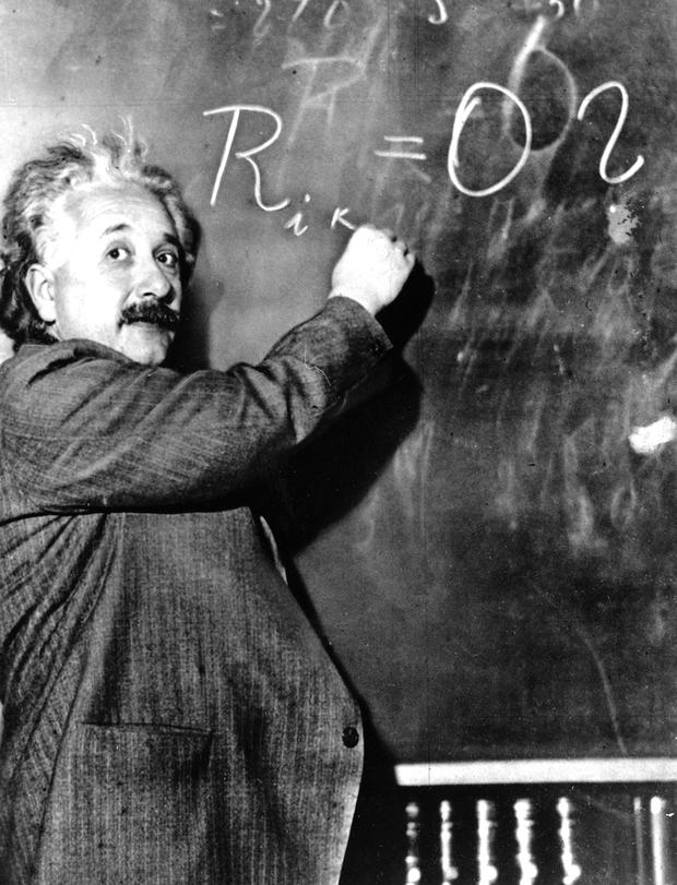 Physicist Albert Einstein writes out an equation for the density of the Milky Way in January 1931