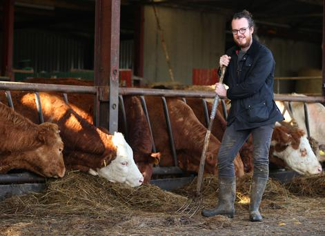 Author John Connell on the family farm in Ballinalee, Co Longford. Photo: Damien Eagers