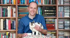 Prof Brendan Kelly pictured the the family cat Trixie. Photo: Frank McGrath